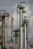 Industrial pipes and chimneys — Stock Photo