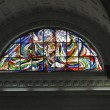 Catholic stained glass window — Stockfoto
