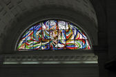 Catholic stained glass window — Stock Photo