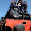 Maintenance of an old steam locomotive — Photo