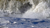 Foam and splashes from a wave — Stock Photo