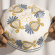 Stock Photo: Embroidery on traditional celebration hat - sub-sahariAfrica