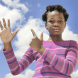 Africchild showing numbers on fingers — Stock Photo #35060753