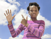 African child showing numbers on the fingers — Stock Photo