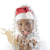 Little girl playing with Christmas decorations — Stock Photo