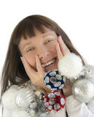 Happy woman playing with Christmas decorations — Stock Photo