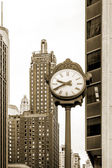 Architecture of Chicago, street clock, loop community area, sepia — Stock Photo