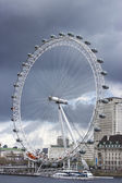 London Eye under a storm, view from Westminster Bridge, UK — Stock fotografie