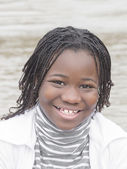 Young Afro beauty near the water — Stock Photo