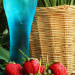 Fruit Strawberry berries on blue water -Onion — Stock Photo