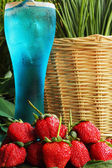 Fruit Strawberry berries on blue water -Onion — Stock fotografie