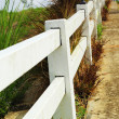 Stock Photo: White fence with road