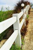 White fence with road — Foto Stock