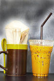 Iced coffee and Tissue paper napkins. in glass. — Stock Photo