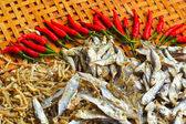 Dry fish in the market and chili red. — Stock Photo