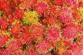 Sweet fruits rambutan in the market. — Stock Photo