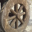 Wagon wheel old - western style. — Stock Photo #36250381