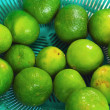 Lemons fruits - green fruit in basket. — Stock Photo #36284729