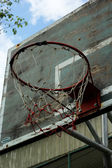 Basketball hoop against the warm summer — Photo