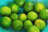 Lemons fruits - green fruit in the basket. — Stock Photo