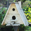 Wooden bird house in nature — Stock Photo #36583353