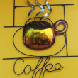 Coffee sign decorate on yellow wall — Stock Photo