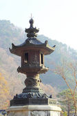 Large old antique lantern post Seoraksan Korea. — Stock Photo
