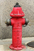 Red Fire Hydrant on the ground — Stock Photo
