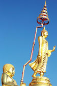 Buddha image in the posture of walking - Temple Thailand. — Stock Photo