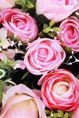 Beautiful rose of artificial flowers — Stock Photo