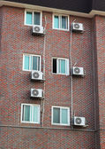 Building wall with windows and air conditioning. — Stock Photo