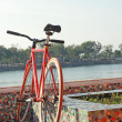 Old bicycle parked beside the pool. — Stock Photo