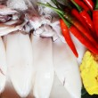 Stock Photo: Fresh squid with garnish for soup.