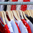 Stock Photo: Shop shirts colorful fabric hanging on a rack.