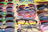 Shop colorful eyewear in the market — Stock Photo