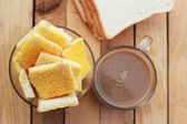 Toast with butter and sprinkling with sugar - hot coffee — Stockfoto