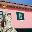 Cupids Statue - with pink buildings. — Stockfoto #39667527