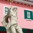 Stockfoto: Cupids Statue - with pink buildings.