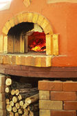 A traditional oven for cooking and baking pizza. — Stock Photo