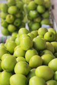 Green apples in the market — Stock Photo