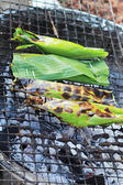 Sticky rice wrapped in banana leaves grill — Stock Photo
