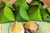 Sticky rice with custard wrapped in banana leaves.  — Stock Photo