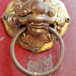 Stock Photo: Old door handles in chinese temple.