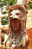 Old wood carved of indian chief head — Stock Photo