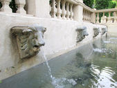 Lion statue  spitting water - vintage style — 图库照片