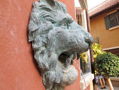 Lion statue  spitting water - vintage style — Stock Photo
