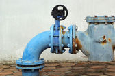 Blue  rusty metal industrial water pipes with a valve. — Stock Photo