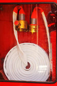 Pipe roll for fire hose emergency in red metal boxes — Stock Photo