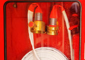Pipe roll for fire hose emergency in red metal boxes — Foto Stock