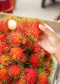Sweet fruits rambutan in the market — Stock Photo